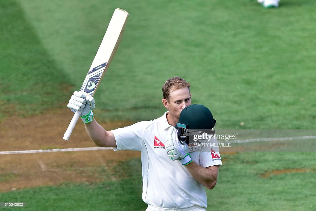 Adam Voges of Australia celebrates 200 runs during day three of the first cricket Test match between New Zealand and Australia at the Basin Reserve in Wellington on February 14, 2016. / AFP / Marty Melville