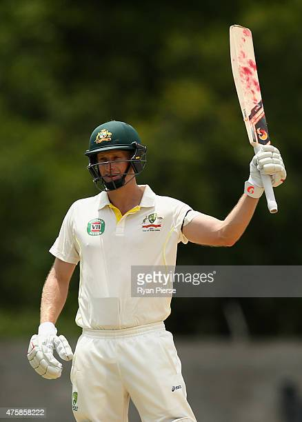 Adam Voges of Australia celebrates after reaching his maiden half century in his debut test during day two of the First Test match between Australia...