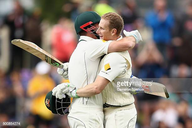 Adam Voges of Australia celebrates scoring 200 runs with team mate Shaun Marsh of Australia during day two of the First Test match between Australia...