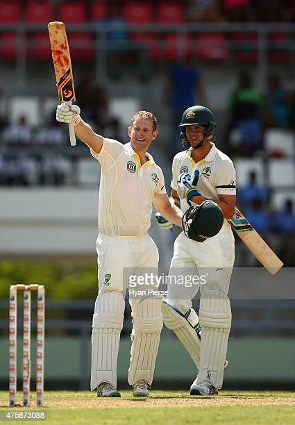 Adam Voges of Australia celebrates with Josh Hazlewood of Australia after Voges reached his maiden century in his debut test during day two of the...
