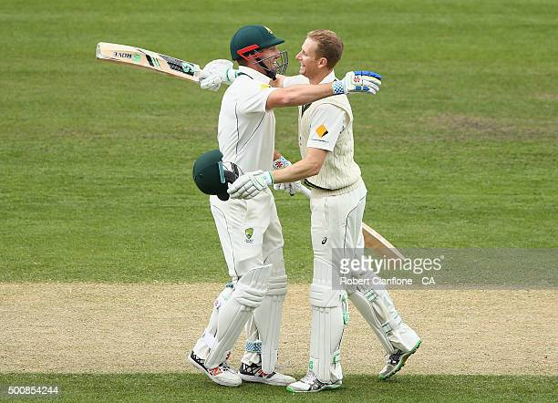 Adam Voges of Australia celebrates with Shaun Marsh after reaching his double century during day two of the First Test match between Australia and...