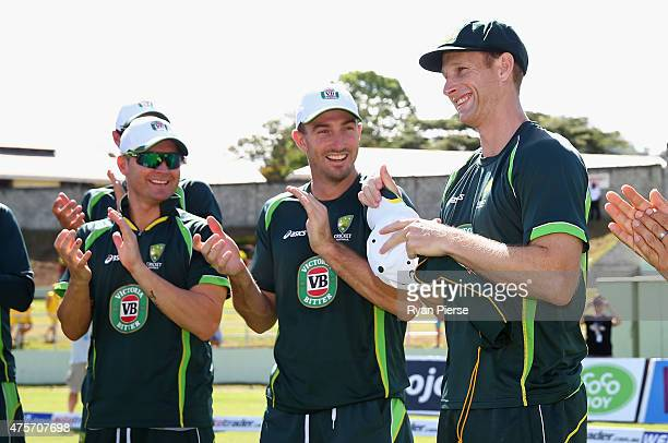 Adam Voges of Australia is congratulated by team mates after he received his Baggy Green Cap from former test player Brendon Julian during day one of...