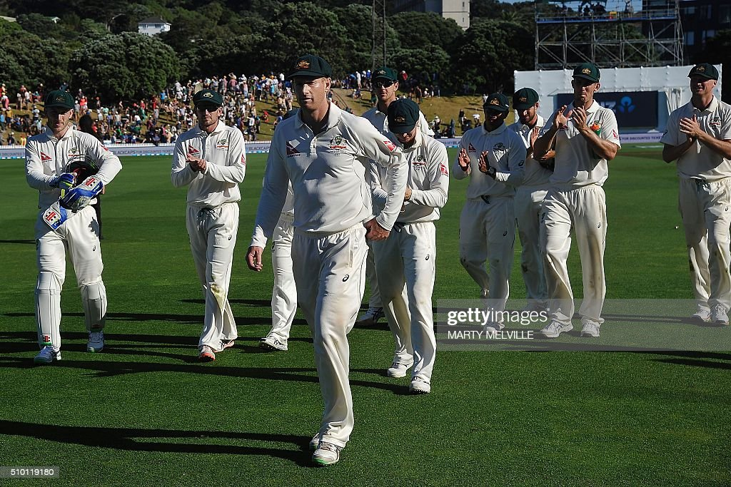 Adam Voges (C) of Australia leads Australia players from the field during day three of the first cricket Test match between New Zealand and Australia at the Basin Reserve in Wellington on February 14, 2016. AFP PHOTO / MARTY MELVILLE / AFP / Marty Melville
