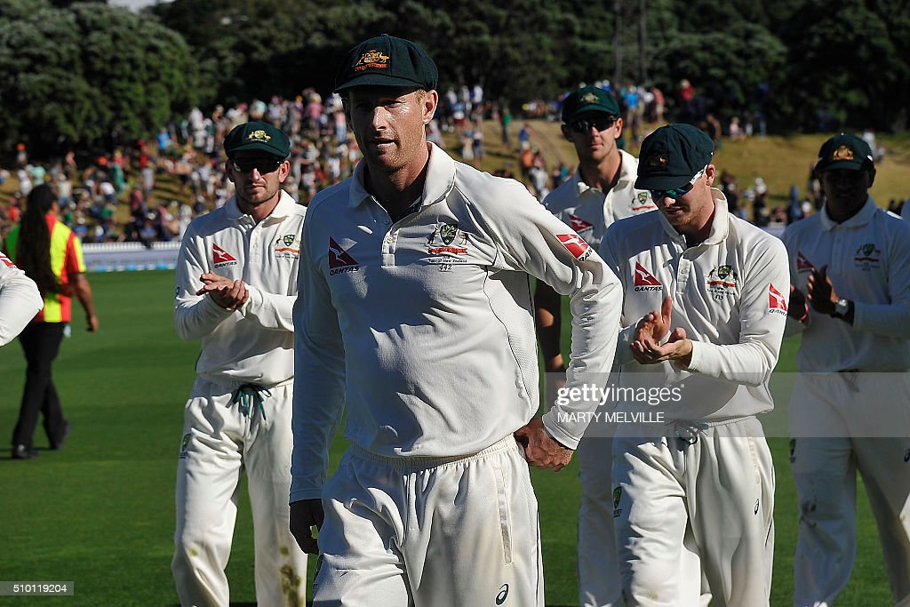Adam Voges (C) of Australia leads Australian players from the field during day three of the first cricket Test match between New Zealand and Australia at the Basin Reserve in Wellington on February 14, 2016. AFP PHOTO / MARTY MELVILLE / AFP / Marty Melville