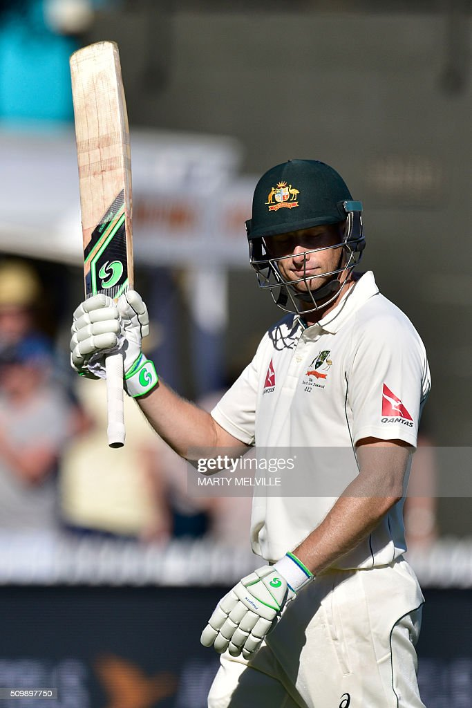 Adam Voges of Australia lifts his bat to the fans as he walks from the field at the end of the days play during day two of the first cricket Test match between New Zealand and Australia at the Basin Reserve in Wellington on February 13, 2016. AFP PHOTO / MARTY MELVILLE / AFP / Marty Melville