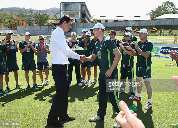 Adam Voges of Australia receives his Baggy Green Cap from former test player Brendon Julian during day one of the First Test match between Australia...