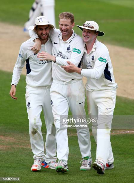 Adam Voges of Middlesex celebrates with his teammates after dismissing Jason Roy of Surrey during day two of the Specsavers County Championship...