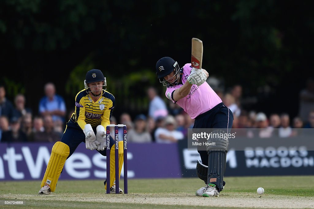 <a gi-track='captionPersonalityLinkClicked' href=/galleries/search?phrase=Adam+Voges&family=editorial&specificpeople=724770 ng-click='$event.stopPropagation()'>Adam Voges</a> of Middlesex hits out as wicketkeeper Adam Wheater of Hampshire looks on during the NatWest T20 Blast between Middlesex and Hampshire at the Uckfield Sports Ground on May 27, 2016 in Uckfield, England.
