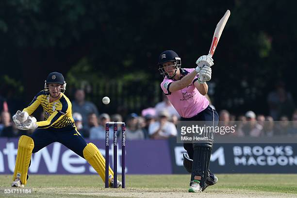 Adam Voges of Middlesex hits out as wicketkeeper Adam Wheater of Hampshire looks on during the NatWest T20 Blast between Middlesex and Hampshire at...