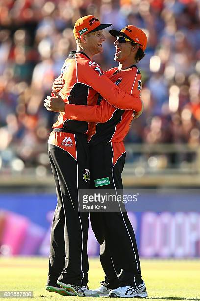 Adam Voges of the Scorchers congratulates Ashton Agar after taking a catch to dismiss Seb Gotch of the Starsduring the Big Bash League match between...