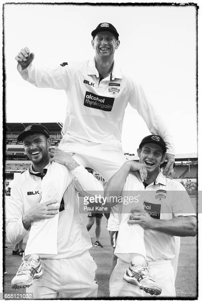 Adam Voges of Western Australia is chaired from the ground by Ashton Turner and Hilton Cartwright after playing his final state game and winning the...