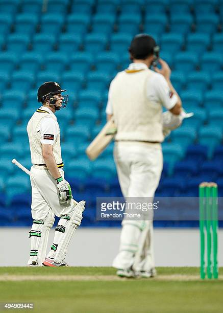 Adam Voges of Western Australia looks on as team mate Cameron Bancroft walks back to the pavilion after being dismissed by Andrew Fekete of Tasmania...