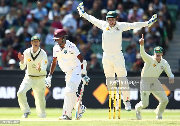 Adam Voges wicketkeeper Peter Nevill and captain Steven Smith celebrate as Nathan Lyon of Australia dismisses Kraigg Brathwaite of the West Indies...
