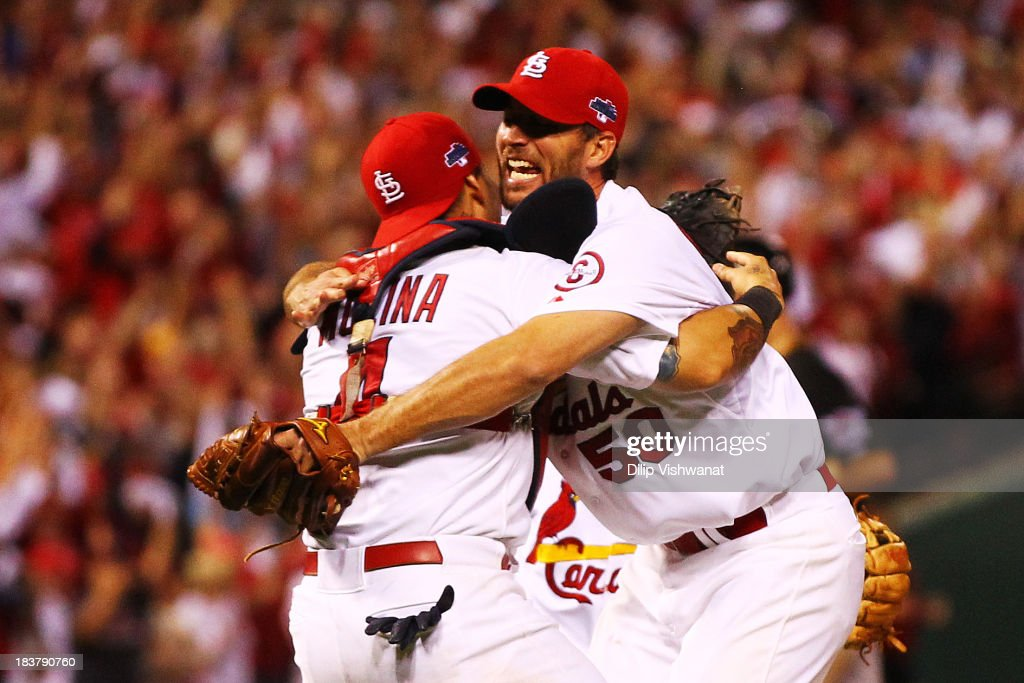 <a gi-track='captionPersonalityLinkClicked' href=/galleries/search?phrase=Adam+Wainwright&family=editorial&specificpeople=547879 ng-click='$event.stopPropagation()'>Adam Wainwright</a> #50 celebrates with <a gi-track='captionPersonalityLinkClicked' href=/galleries/search?phrase=Yadier+Molina&family=editorial&specificpeople=172002 ng-click='$event.stopPropagation()'>Yadier Molina</a> #4 of the St. Louis Cardinals after they defeated the Pittsburgh Pirates 6 to 1 in Game Five of the National League Division Series at Busch Stadium on October 9, 2013 in St Louis, Missouri.