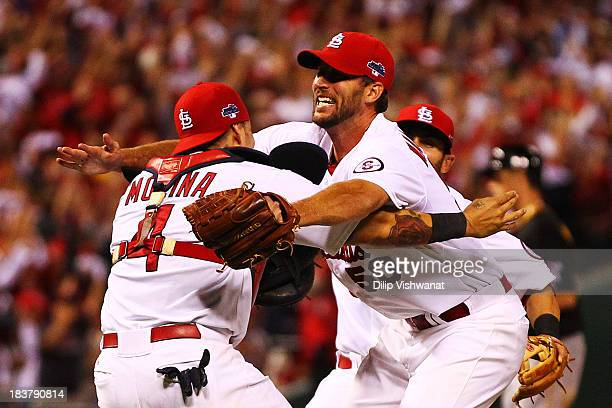 Adam Wainwright celebrates with Yadier Molina of the St Louis Cardinals after they defeated the Pittsburgh Pirates 6 to 1 in Game Five of the...