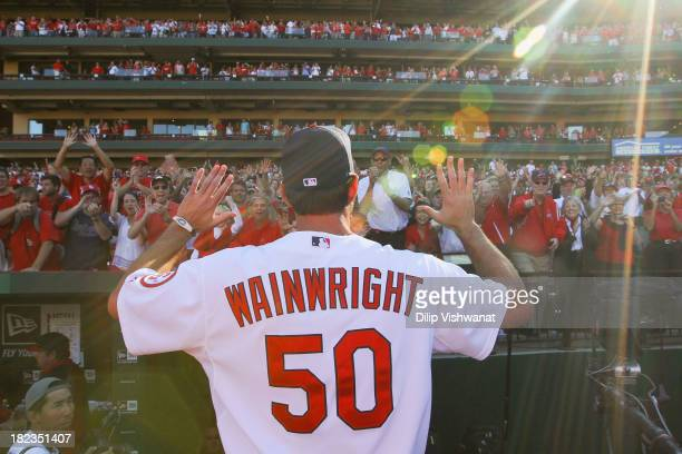 Adam Wainwright of the St Louis Cardinals acknowledges the fans after playing the Chicago Cubs in the final game of the regular season at Busch...