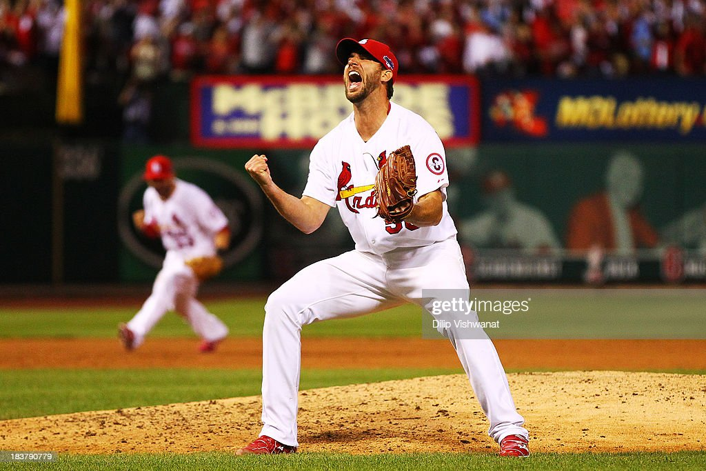 <a gi-track='captionPersonalityLinkClicked' href=/galleries/search?phrase=Adam+Wainwright&family=editorial&specificpeople=547879 ng-click='$event.stopPropagation()'>Adam Wainwright</a> #50 of the St. Louis Cardinals celebrates defeating the Pittsburgh Pirates 6 to 1 in Game Five of the National League Division Series at Busch Stadium on October 9, 2013 in St Louis, Missouri.