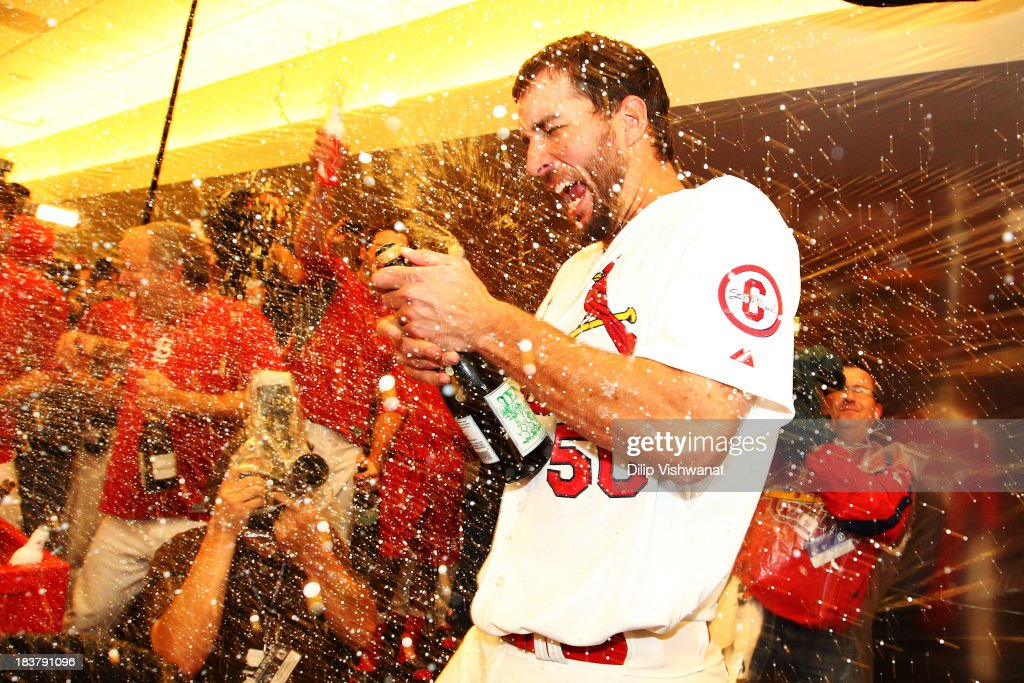 <a gi-track='captionPersonalityLinkClicked' href=/galleries/search?phrase=Adam+Wainwright&family=editorial&specificpeople=547879 ng-click='$event.stopPropagation()'>Adam Wainwright</a> #50 of the St. Louis Cardinals celebrates in the locker room after their 6 to 1 win over the Pittsburgh Pirates in Game Five of the National League Division Series at Busch Stadium on October 9, 2013 in St Louis, Missouri.