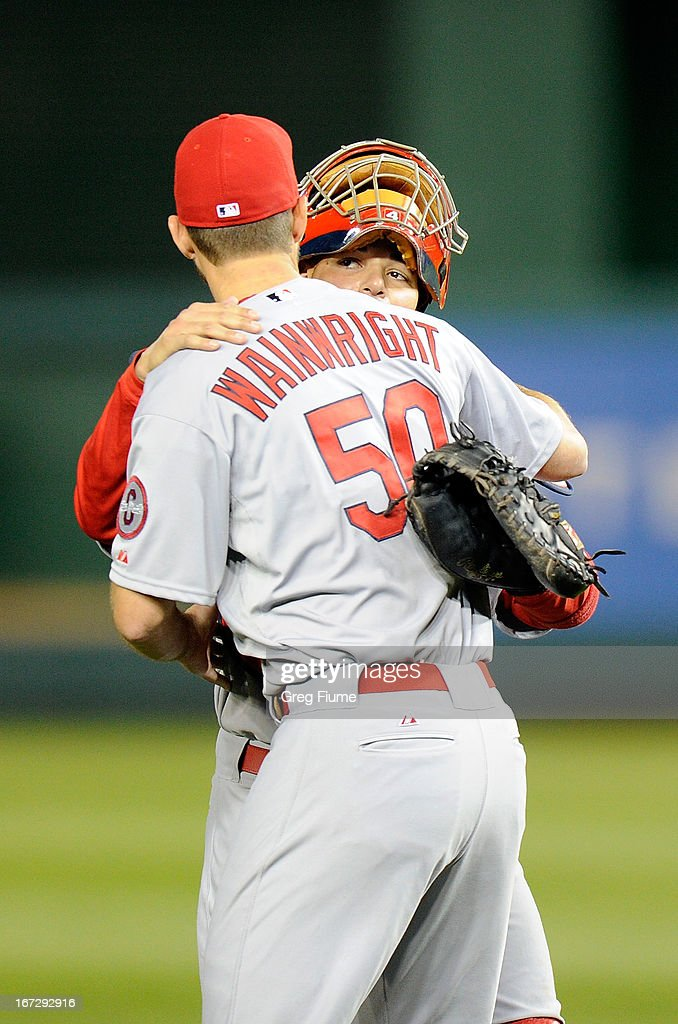 <a gi-track='captionPersonalityLinkClicked' href=/galleries/search?phrase=Adam+Wainwright&family=editorial&specificpeople=547879 ng-click='$event.stopPropagation()'>Adam Wainwright</a> #50 of the St. Louis Cardinals celebrates with <a gi-track='captionPersonalityLinkClicked' href=/galleries/search?phrase=Yadier+Molina&family=editorial&specificpeople=172002 ng-click='$event.stopPropagation()'>Yadier Molina</a> #4 after a 2-0 victory against the Washington Nationals at Nationals Park on April 23, 2013 in Washington, DC.