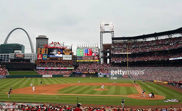Adam Wainwright of the St Louis Cardinals delivers a pitch in the second inning against the Colorado Rockies on opening day at Busch Stadium March 31...