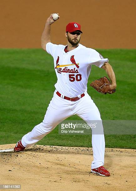 Adam Wainwright of the St Louis Cardinals pitches in the first inning against the Boston Red Sox during Game Five of the 2013 World Series at Busch...