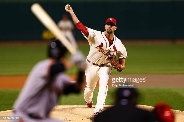 Adam Wainwright of the St Louis Cardinals pitches in the first inning against the San Francisco Giants during Game One of the National League...