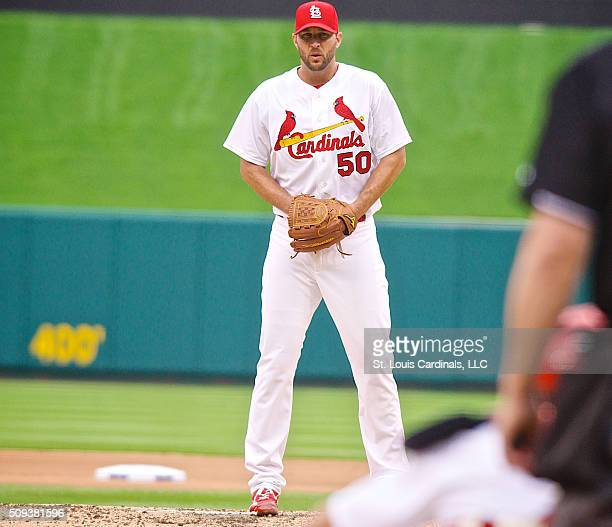 Adam Wainwright of the St Louis Cardinals prepares to pitch on opening day against the Milwaukee Brewers on April 13 2015 at Busch Stadium in St...
