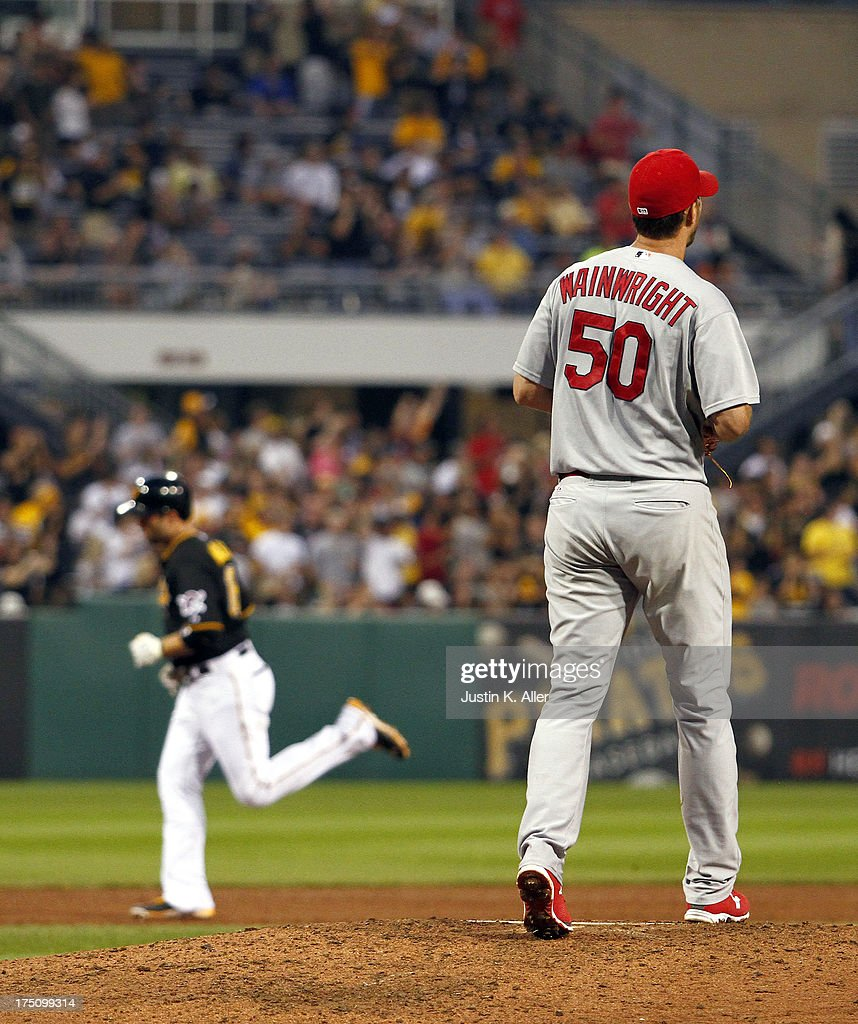 Adam Wainwright #50 of the St. Louis Cardinals reacts after Neil Walker #18 of the Pittsburgh Pirates hit a solo home run in the third inning during the game on July 31, 2013 at PNC Park in Pittsburgh, Pennsylvania.