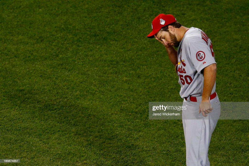 <a gi-track='captionPersonalityLinkClicked' href=/galleries/search?phrase=Adam+Wainwright&family=editorial&specificpeople=547879 ng-click='$event.stopPropagation()'>Adam Wainwright</a> #50 of the St. Louis Cardinals reacts against the Boston Red Sox during Game One of the 2013 World Series at Fenway Park on October 23, 2013 in Boston, Massachusetts.