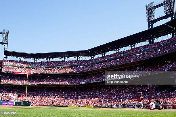 Adam Wainwright of the St Louis Cardinals throws the first pitch to Michael Bourn of the Houston Astros in the home opener at Busch Stadium on April...