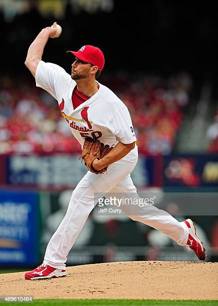 Adam Wainwright of the St Louis Cardinals throws to a Milwaukee Brewers batter during the first inning at Busch Stadium on April 13 2015 in St Louis...