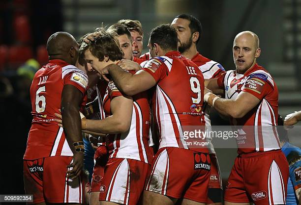 Adam Walne of Salford Red Devils celebrates his try with team mates during the First Utility Super League match between Salford City Reds and St...
