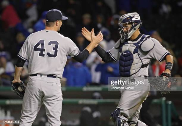 Adam Warren and Gary Sanchez of the New York Yankees celebrate a win over the Chicago Cubs at Wrigley Field on May 6 2017 in Chicago Illinois The...