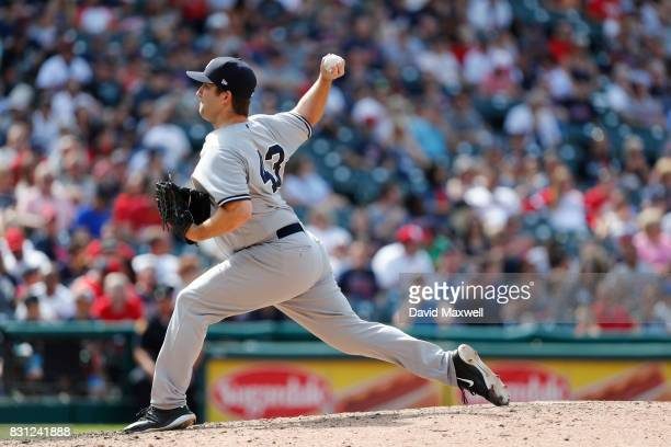 Adam Warren of the New York Yankees pitches against the Cleveland Indians in the eighth inning at Progressive Field on August 6 2017 in Cleveland...
