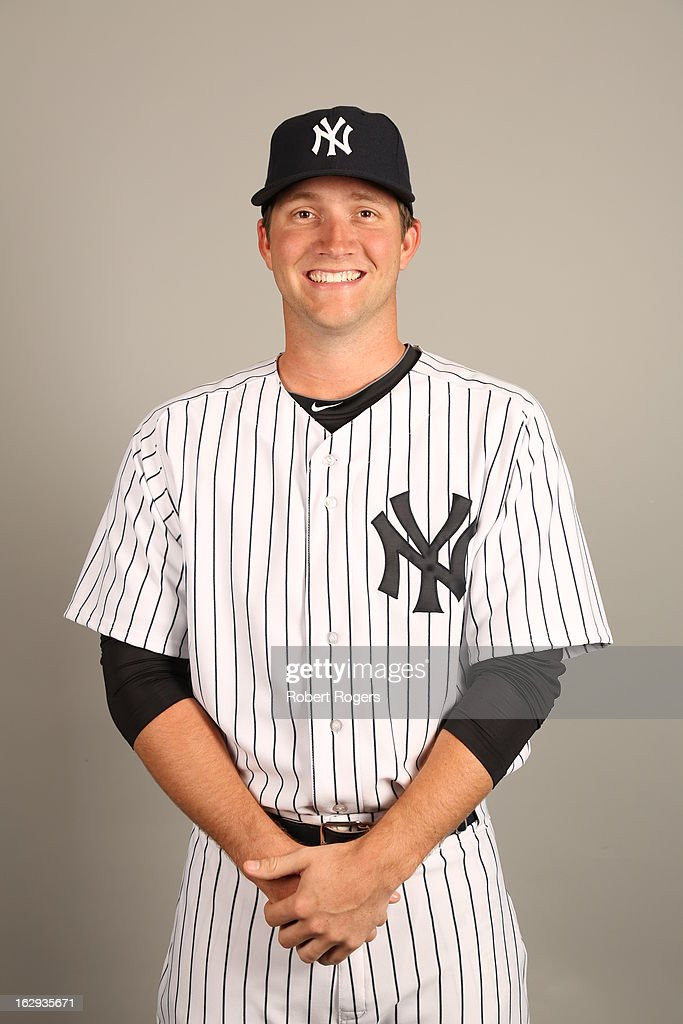Adam Warren #61 of the New York Yankees poses during Photo Day on February 20, 2013 at George M. Steinbrenner Field in Tampa, Florida.