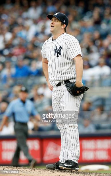 Adam Warren of the New York Yankees reacts in an MLB baseball game against the Tampa Bay Rays on July 29 2017 at Yankee Stadium in the Bronx borough...