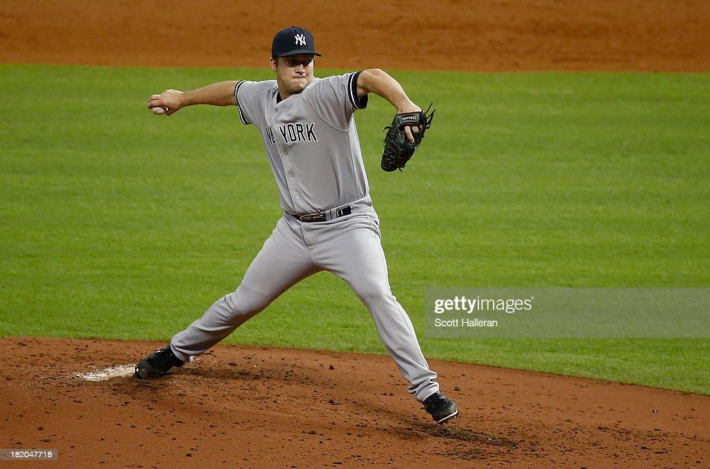 Adam Warren #43 of the New York Yankees throws a pitch in the third inning against the Houston Astros at Minute Maid Park on September 27, 2013 in Houston, Texas.