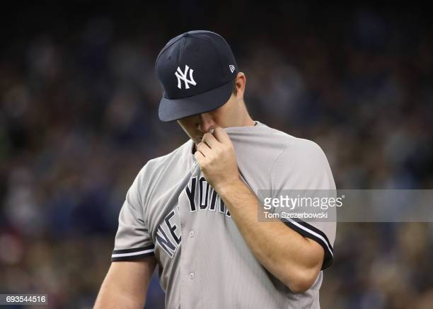 Adam Warren of the New York Yankees walks off the mound and towards his dugout at the end of the seventh inning during MLB game action against the...