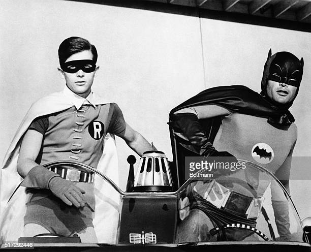 Adam West and Burt Ward as Batman and Robin atop the Batmobile in the famously campy TV series 'Batman'