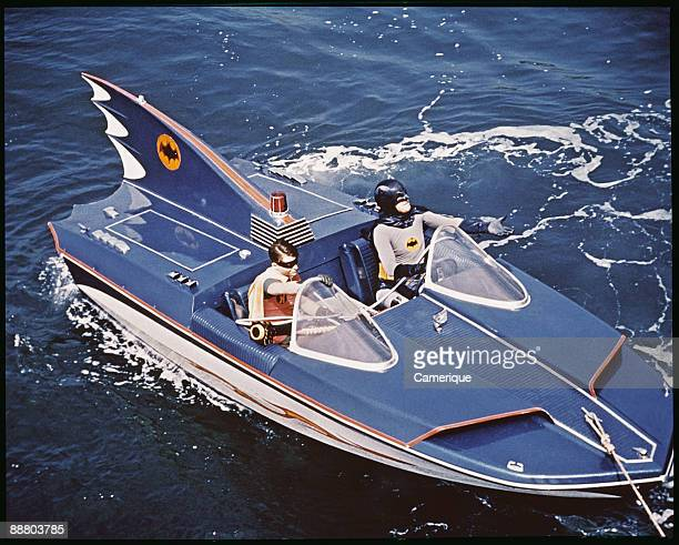 Adam West and Burt Ward as Batman and Robin riding the Bat Boat from the television series 'Batman' 1966