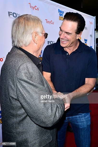 Adam West and Patrick Warburton attend the Launch Party for the 'Family Guy' Game at the Happy Ending Bar Restaurant on April 2 2014 in Hollywood...