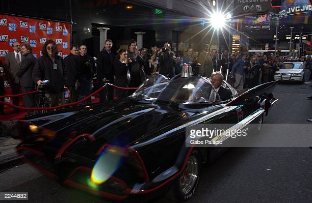 Adam West 'Batman' arrives in his original Batmobile at the TV Land and Nick at Nite Upfront in 'The Bat Cave' on Broadway in New York City on April...