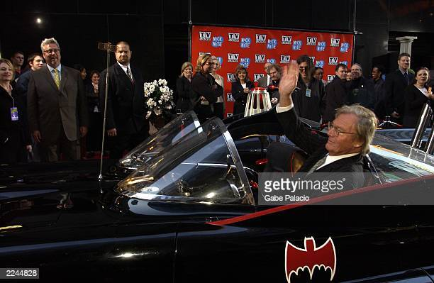 Adam West 'Batman' waves to Larry Jones General Manager of TV Land and Nick at Nite as he arrives in his original Batmobile to the TV Land and Nick...