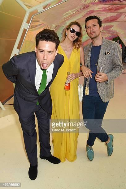 Adam Weymouth Greta Bellamacina and Robert Montgomery attend The Serpentine Gallery summer party at The Serpentine Gallery on July 2 2015 in London...