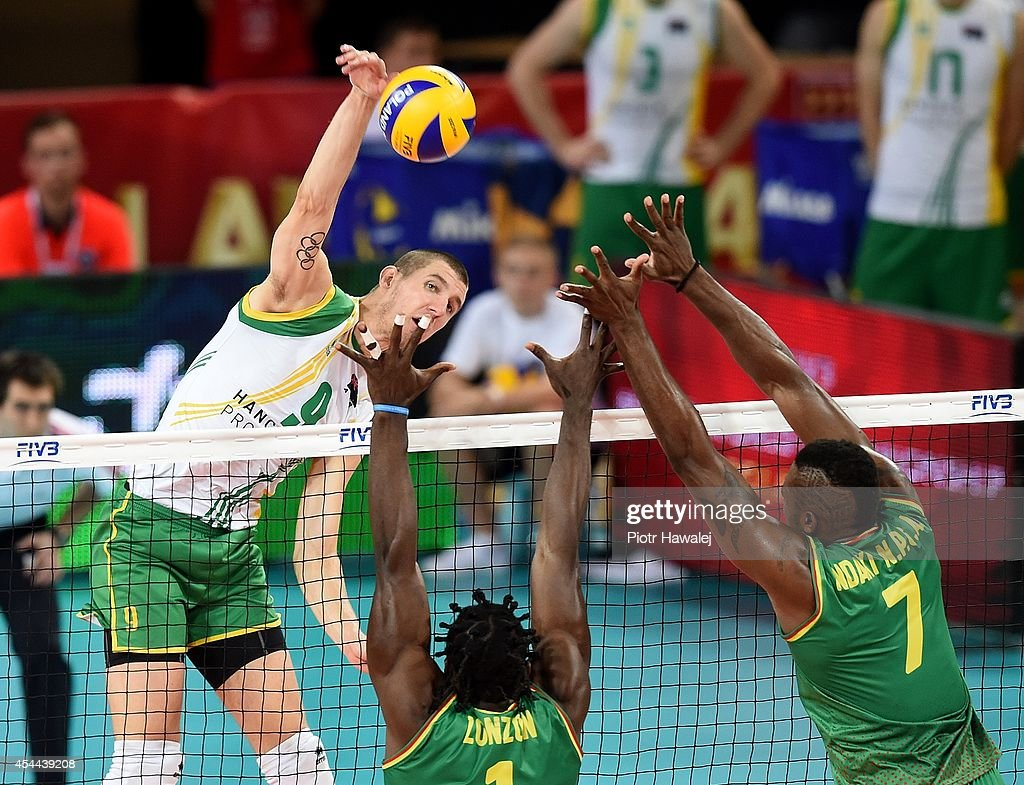 Adam White of Australia spikes the ball during the FIVB World Championships match between Cameroon and Australia on August 31, 2014 in Wroclaw, Poland.