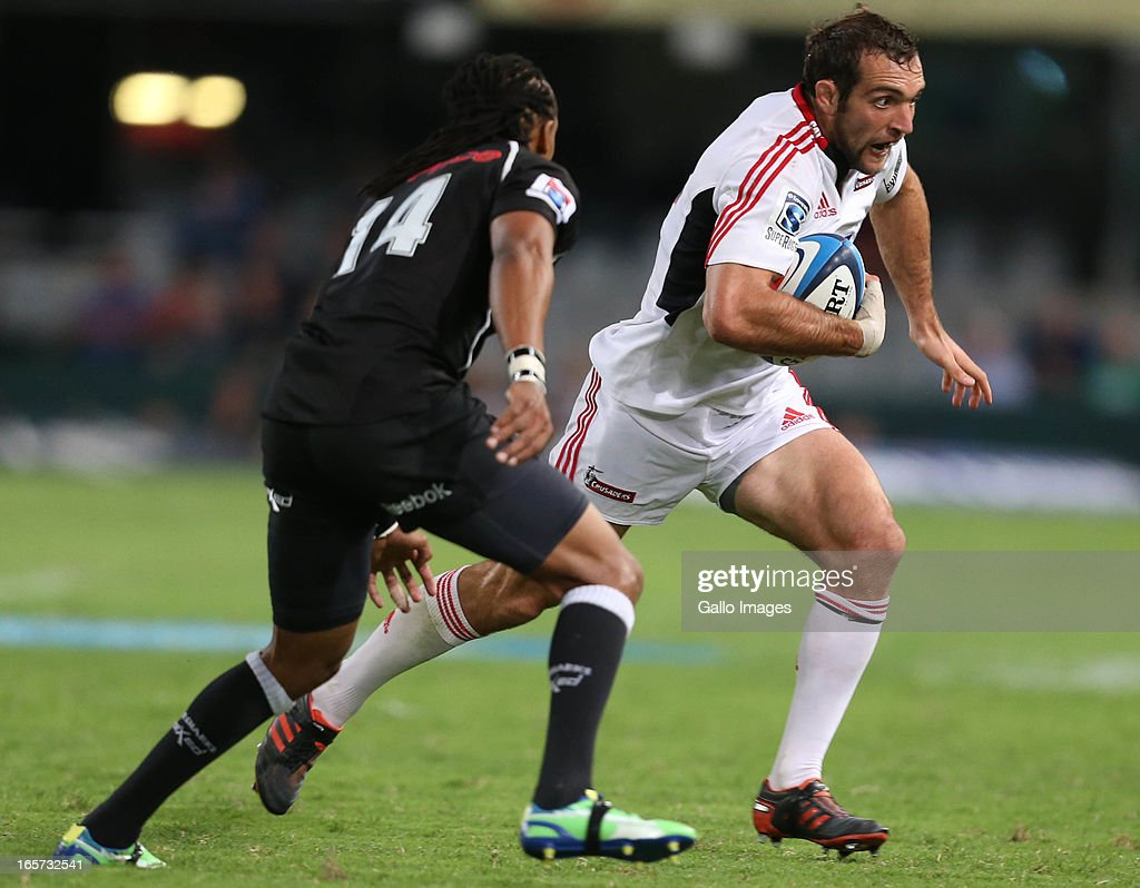 Adam Whitelock of Crusaders goes around Odwa Ndunganeu of Sharks during the Super Rugby match between The Sharks and Crusaders from Kings Park on April 05, 2013 in Durban, South Africa.