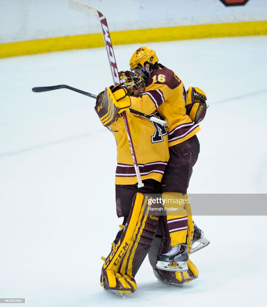 Adam Wilcox #32 and Nate Condon #16 of the Minnesota Golden Gophers celebrate a win in the final game against the St. Cloud State Huskies in the West Regional of the 2014 NCAA Division I Men's Ice Hockey Championship on March 30, 2014 at Xcel Energy Center in St Paul, Minnesota. The Minnesota Golden Gophers defeated the St. Cloud State Huskies 4-0.