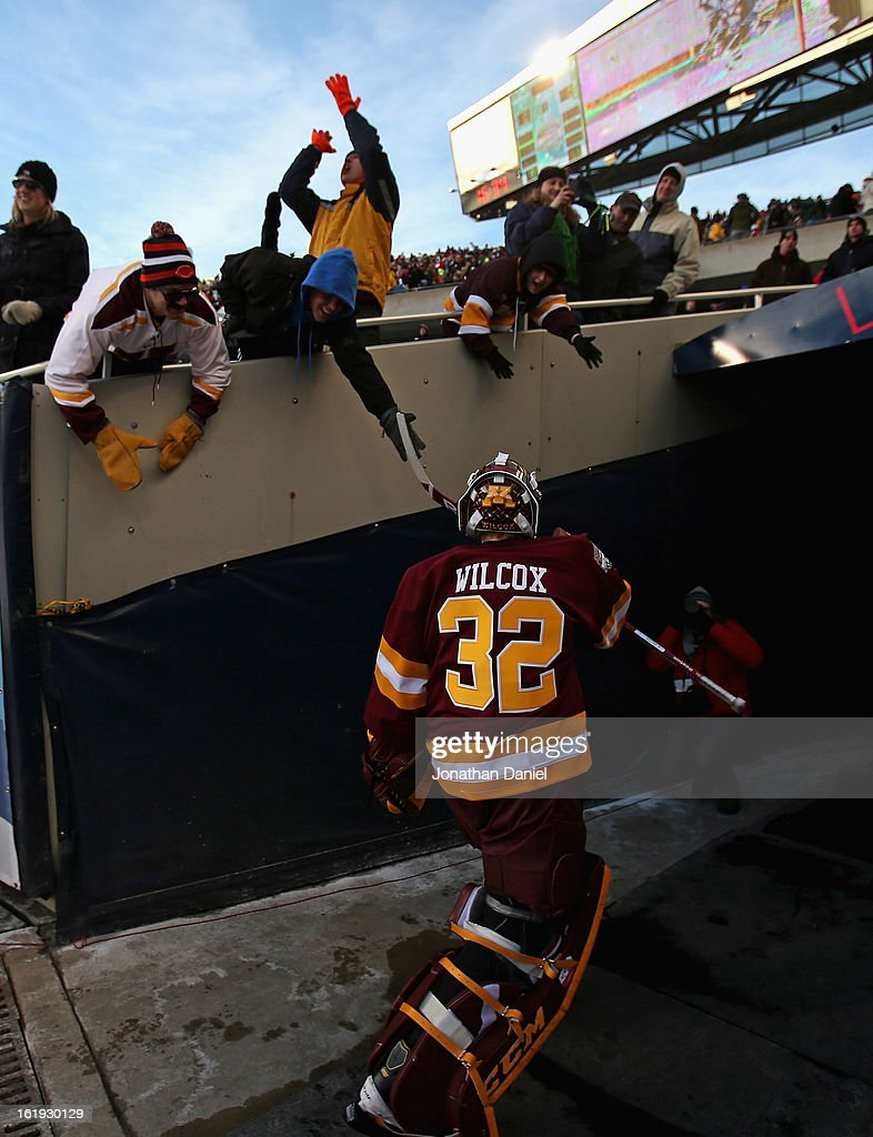 Adam Wilcox #32 of the Minnesota Golden Gorphers greets a fan in between periods of a game against the Wisconsin Badgers during the Hockey City Classic at Soldier Field on February 17, 2013 in Chicago, Illinois.