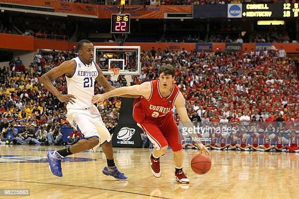 Adam Wire of the Cornell Big Red drives against Perry Stevenson of the Kentucky Wildcats uring the east regional semifinal of the 2010 NCAA men's...