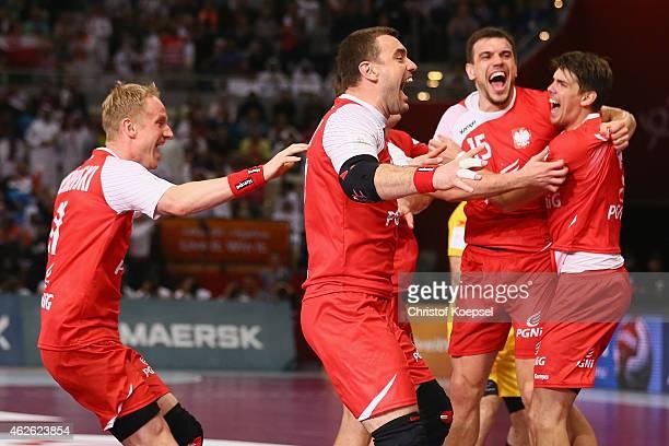 Adam Wisniewski Bartosz Jurecki Michal Jurecki and Piotr Chrapkowski of Poland celebrate after the third place match between Poland and Spain in the...